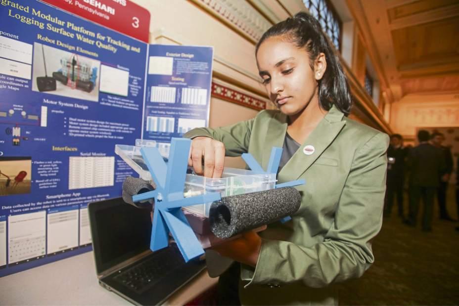 Meghna displays her aqua-bot creation in Washington.