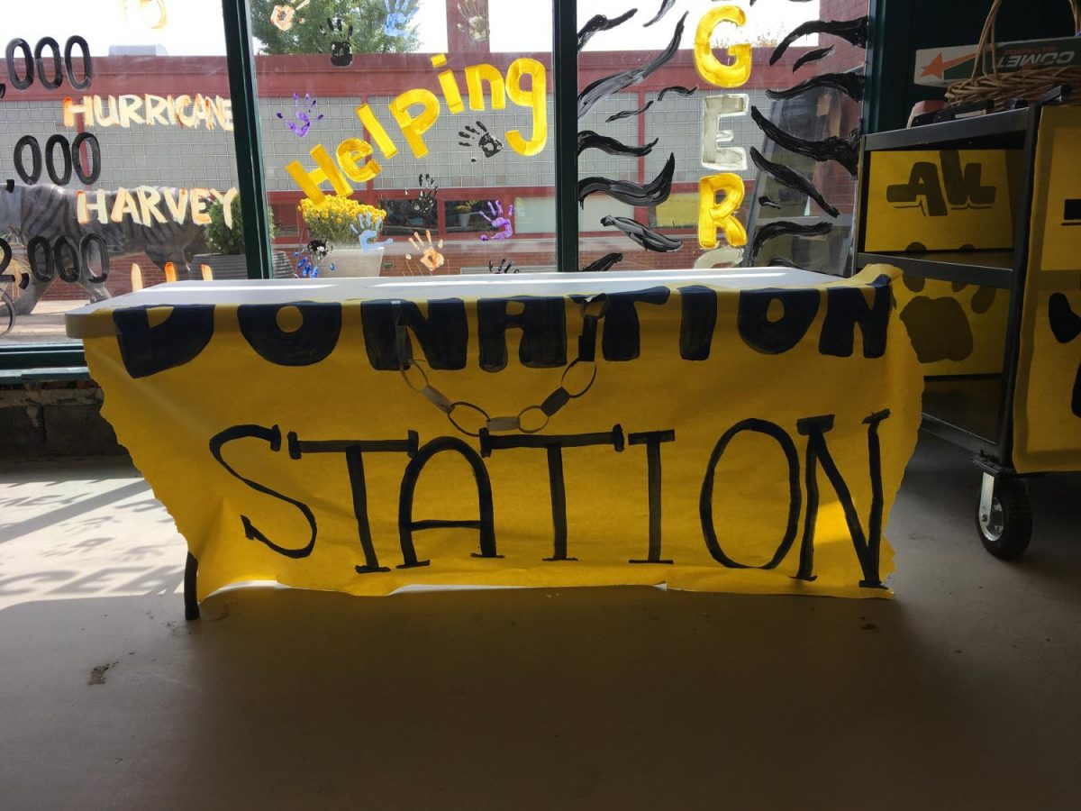 The donation stations are situated around school premises to remind students to contribute to the Hurricane Harvey fundraiser. Buying links and homecoming tickets are a way to donate and help others.