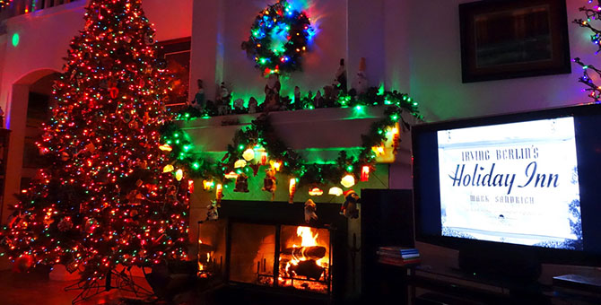 A+family+enjoying+a+Christmas+movie+in+their+home+theater.