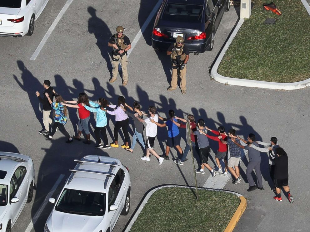 Students are escorted out of Marjory Stoneman High School