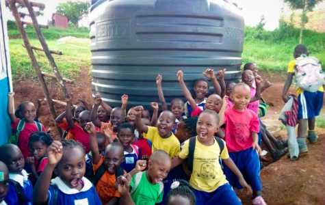 Children in Uganda are overjoyed when they recieved a water harvesting system.