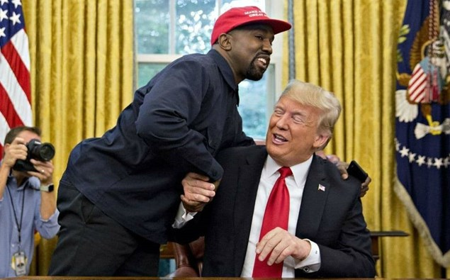 Kanye West and Donald Trump embracing in the Oval Office.