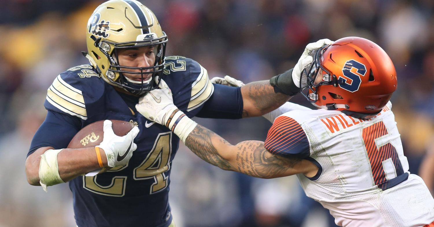 James Conner stiff arms Syracuse defender Rodney Williams