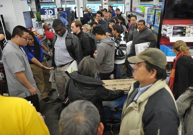 Shoppers are seen inside of a Best Buy store which began their Black Friday sale at midnight on November 22, 2012 in Rockville, Maryland. Thanksgiving, the last US holiday undisturbed by mass commercialization, is now victim to the ever advancing Christmas shopping season, with stores welcoming shopaholics before the family turkey can be taken from the oven.