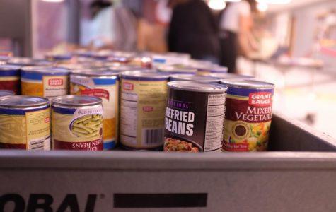 Cans of food that were collected from NAI homerooms to give to the North Hills Food Bank.