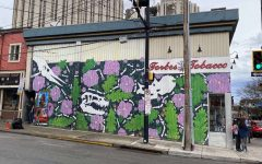 A unique mural displayed on the side of the Forbes Tobacco shop in oakland, that features dinosaurs, purple flowers, and green leaves.