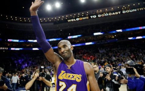 Los Angeles Lakers' Kobe Bryant waves to the crowd after an NBA basketball game against the Philadelphia 76ers, Tuesday, Dec. 1, 2015, in Philadelphia. Philadelphia won 103-91. (AP Photo/Matt Slocum)
