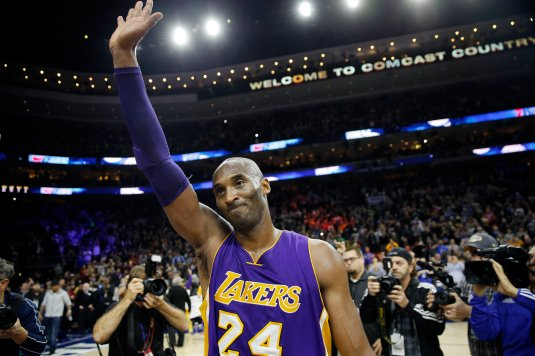 Los Angeles Lakers' Kobe Bryant waves to the crowd after an NBA basketball game against the Philadelphia 76ers, Tuesday, Dec. 1, 2015, in Philadelphia. Philadelphia won 103-91. (AP Photo/Matt Slocum)