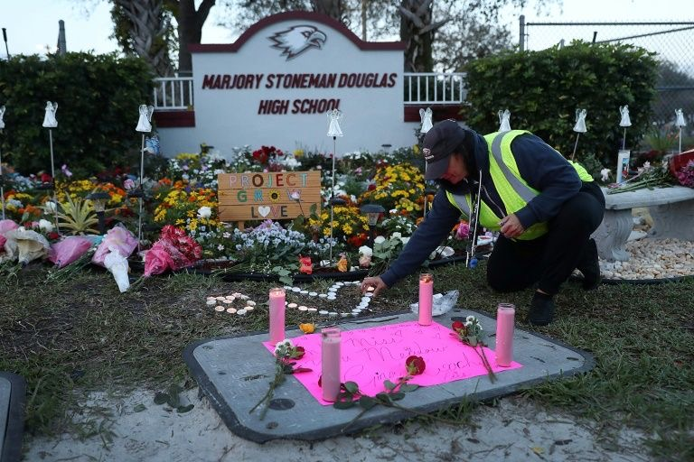 A+memorial+at+Marjory+Stoneman+Douglas+high+school+for+the+victims+of+the+Parkland+Shooting+on+February+14%2C+2018