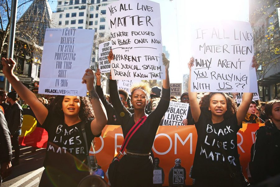 Women at a Black Lives Matter rally protesting against the implied racism behind  the