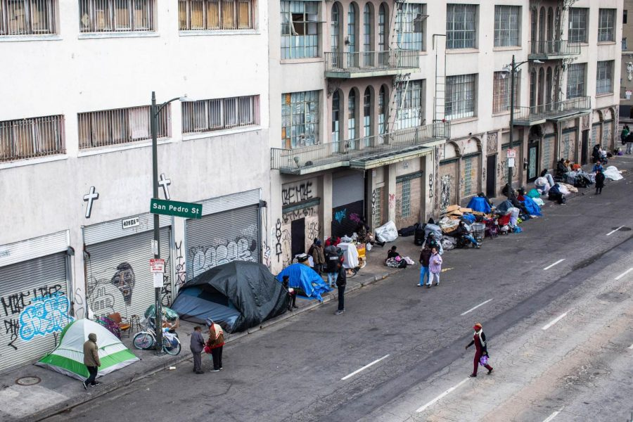 In Los Angeles, many homeless people set up tents in an attempt to social distance.