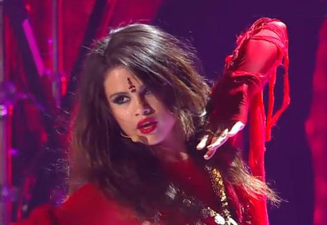 Selena Gomez wearing a bindi and Indian garments in a performance at the MTV Movie Awards.
