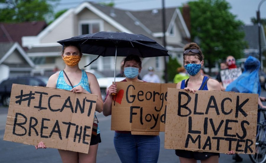 White+protesters+march+in+solidarity+with+their+black+community+in+Minneapolis%2C+Minnesota+to+bring+justice+to+the+death+of+George+Floyd.
