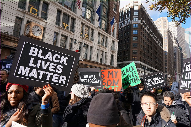 Protestors at a Black Lives Matter protest fighting for Black rights and the memory of victims.