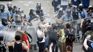 Police spray mace at protestors in Minneapolis, Minnesota.