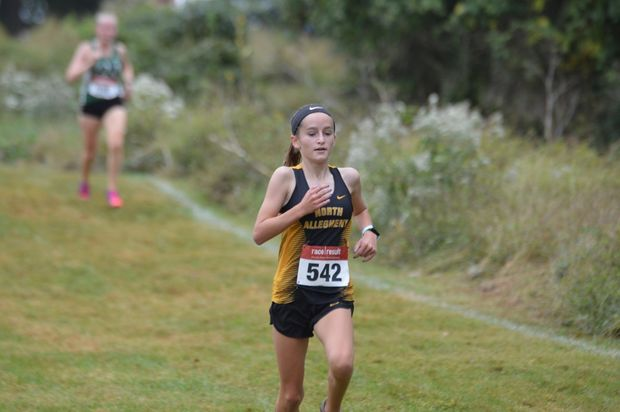 Eva Kynaston mid race at the PIAA Foundation XC Invite, where she took 2nd for North Allegheny and 14th overall.