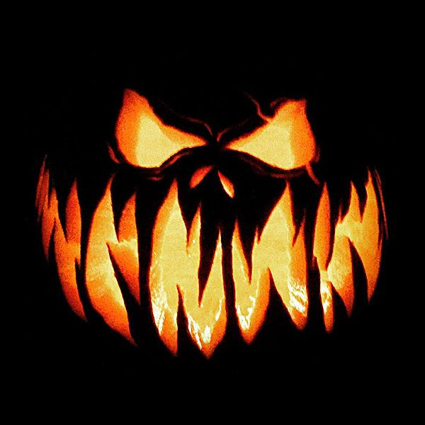 A spooky Jack-o-Lantern glows brightly during Halloween.