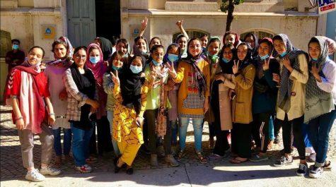 The Afghan Womens Soccer Team celebrates after arriving in Lisbon, Portugal on Sept. 19, 2021.
