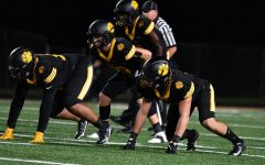 The Tigers defense lines up against Central Catholic on Sept. 24.
